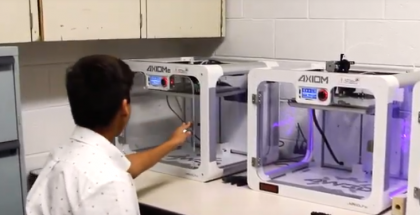 Student working with 3-D printer