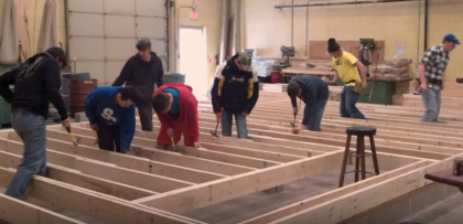 Students work on lumber