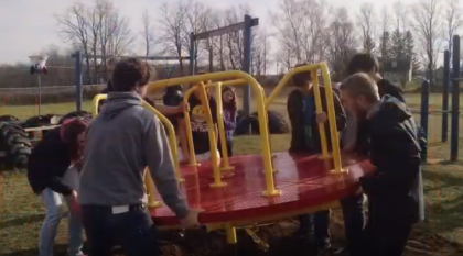 Students help on playground