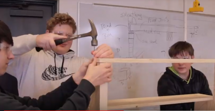 Student hammers a nail