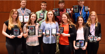 Students posing with awards from competition