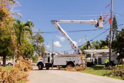 Lineman fixing power lines on street