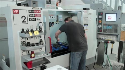 Machinist working at computer controlled machine