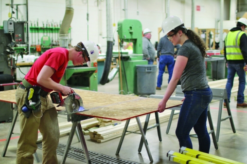 Students cutting plywood during skills challenge